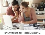 serious man and woman sitting... | Shutterstock . vector #588038042