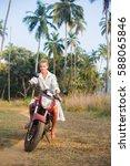 Small photo of Mrs. Claus (Snegurochka) on the bike in Goa.