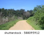 dirt road leading through a... | Shutterstock . vector #588095912