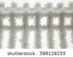 ice frozen iron fence with... | Shutterstock . vector #588128255