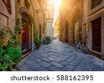 narrow old cozy street in lucca ... | Shutterstock . vector #588162395