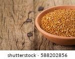 millet on wooden background | Shutterstock . vector #588202856