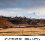 farm nestled under the glacier...   Shutterstock . vector #588243992