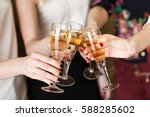 hands holding the glasses of... | Shutterstock . vector #588285602