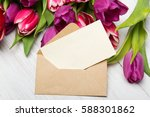 tulip bouquet and envelope on... | Shutterstock . vector #588301862