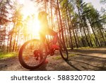 woman riding a mountain bicycle ... | Shutterstock . vector #588320702