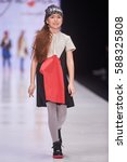 a model walks the runway on the ... | Shutterstock . vector #588325808