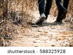couple walking on way in forest | Shutterstock . vector #588325928