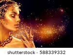 gold woman makeup  golden skin. ... | Shutterstock . vector #588339332