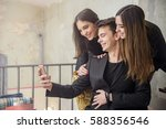 friends having fun with phone... | Shutterstock . vector #588356546