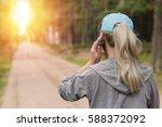 sport woman talking on phone...   Shutterstock . vector #588372092