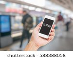 hand holding mobile phone with... | Shutterstock . vector #588388058
