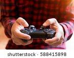 men control games.a young man...   Shutterstock . vector #588415898