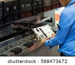 operator bending metal sheet by ... | Shutterstock . vector #588473672