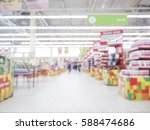 Small photo of Abstract blurred supermarket aisle with colorful shelves as background