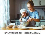 happy family in the kitchen.... | Shutterstock . vector #588502532