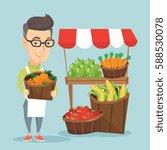Caucasian Greengrocer Standing...