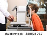 at the optician  optometrist in ... | Shutterstock . vector #588535082