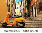 orange vintage scooter on the... | Shutterstock . vector #588542078
