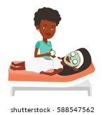cosmetologist applying mask on... | Shutterstock .eps vector #588547562