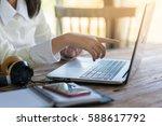 woman right forefinger poiting...   Shutterstock . vector #588617792