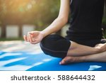 woman practicing meditation... | Shutterstock . vector #588644432