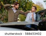 two men arguing after a car... | Shutterstock . vector #588653402