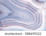 Stock photo detail of a translucent slice of natural stone agate natural concentric patterns and textures of 588659222