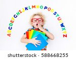 happy preschool child learning... | Shutterstock . vector #588668255