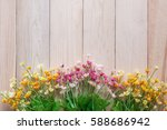 artificial flowers on wooden... | Shutterstock . vector #588686942