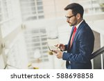handsome businessman using... | Shutterstock . vector #588698858