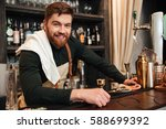 image of cheerful young bearded ... | Shutterstock . vector #588699392