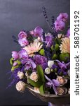 Small photo of Bouquet of vanda orchid , gerbera flowers on gray background