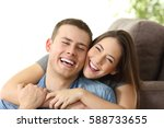 happy couple with perfect white ... | Shutterstock . vector #588733655
