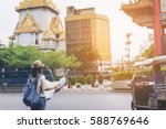 young woman traveler with sky... | Shutterstock . vector #588769646