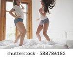 diverse girl friends dancing to ... | Shutterstock . vector #588786182