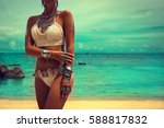 slim and tanned girl in trendy... | Shutterstock . vector #588817832