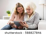 grandmother learning how to use ... | Shutterstock . vector #588827846