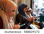 group of british muslim women... | Shutterstock . vector #588829172
