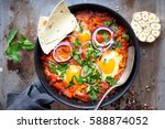 shakshuka with pita bread in a... | Shutterstock . vector #588874052