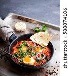 shakshuka with pita bread in a...   Shutterstock . vector #588874106