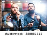 men with a beard sitting on the ... | Shutterstock . vector #588881816