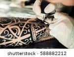 master tattoo artist in gloves... | Shutterstock . vector #588882212
