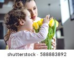 young  glad mother having fun...   Shutterstock . vector #588883892