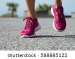 runner woman feet running on...   Shutterstock . vector #588885122