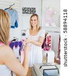 pretty saleswoman giving... | Shutterstock . vector #58894118