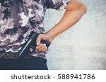 man holding gun. criminal... | Shutterstock . vector #588941786