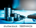 row of coins car remote and pen ... | Shutterstock . vector #588944426