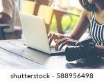 young woman photographer... | Shutterstock . vector #588956498