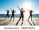 silhouettes of sportive girls... | Shutterstock . vector #588978092